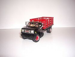Dcp First Gear 1/64 Black Cab Red Stake Side Gmc 6500 Single Axle Stake Truck