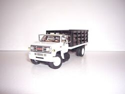 Dcp First Gear 1/64 White Cab Black Stake Side Gmc 6500 Single Axle Stake Truck