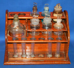 An Antique Wooden Apothecary Rack For Tubes And Bottles, With Contents