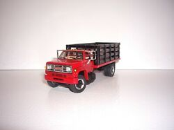 Dcp First Gear 1/64 Red Cab And Black Stake Gmc 6500 Single Axle Stake Truck