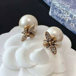 Tribales Earrings Antique Gold-finish Metal With White Resin Pearls And Bee Design
