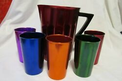 Six Bascal Aluminum Tumblers And Pitcher With A Bakelite Handle Colorful