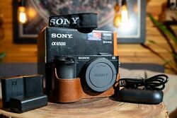 Sony A6500 24.2mp Digital Camera-batteries/charger/cable- Leather Grip Case