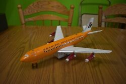 Rare Orange Marx Tin Lithograph Braniff Airlines Astro Jet 727 Battery Toy Plane