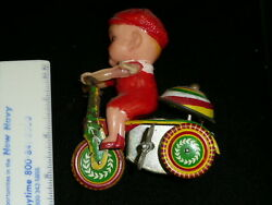 Vintage Tin Wind-up Toy Tricycle Celluloid Boy Child -part Of Arm Missing-works