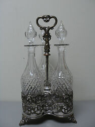 Elegant 3-bottle Tantalus, Tall Crystal Decanters And Silver Plate Stand
