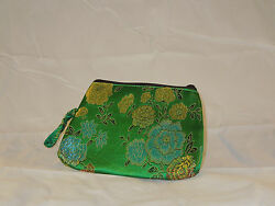 green oriental clutch purse with opalescent floral design $15.99
