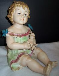 Antique German Bisque Porcelain Piano Baby Girl And Holding A Doll Huge
