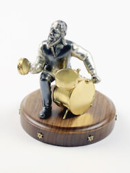 Silver Figurine Musician With A Drum