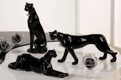 Set of 3 black ceramic panthers. Models from 885 to 11 inches in length