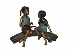 Boy And Girl On A Tree Log Reading Bronze Statue - Size 37l X 14w X 27h.