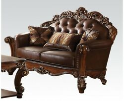Vendome Victorian Brown Faux Leather Loveseat With Carved Wood Accents