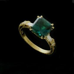 Synthetic Emerald Gold Baguettes Diamond Engraved Engagement Ring