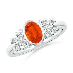Vintage Style Bezel-set Oval Fire Opal Ring With Diamonds In Gold/platinum