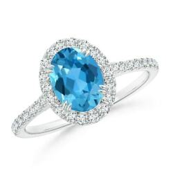 Double Claw-set Oval Swiss Blue Topaz Halo Ring With Diamonds In Gold/platinum