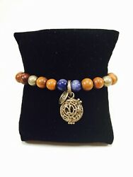 Lisa Hoffman Antique Brass And Wood Beaded Stretch Fragrance Bracelet With Charm