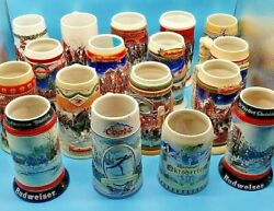 LOT OF 17 HOLIDAY BUDWEISER COLLECTORS BEER STEINS.  SET 1987 - 2012 STEIN MUGS