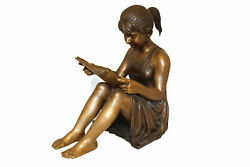 Girl Sitting And Reading A Book Bronze Statue - Size 23l X 15w X 24h.