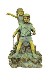 Life Size Bronze Statue Of Boy And Girl Playing Car