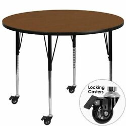 Mobile 48and039and039 Round Activity Table With 1.25and039and039 Thick High Pressure Oak Laminate