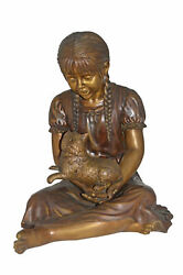 Girl Holding Her Cat Life Size Bronze Statue - Size 23l X 20w X 24h.