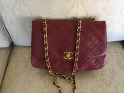 Beautiful seldom used preowned authentic red Chanel bag. $1500.00