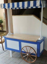 One Of A Kind Vendor Cart. New Festive Unit Made Of Wood With Amish Wagon Wheels