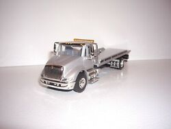 Speccast 1/64 Silver International 8600 Single Axle Rollback Flatbed Dcp