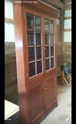 Chippendale Mid 1800's Cherry Corner Cabinet With Beveled Glass Panels.