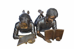 A Set Of Boy And Girl Reading Books Bronze Statue - Size 31l X 10w X 14h.