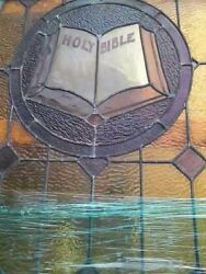 Vintage Stain Glass Church Windows With A Bible In The Center