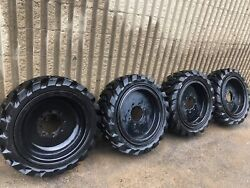 4 Used Solid Skid Steer Tires 10x16.5. Includes Rims