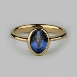 Oval Halo Ring 14 Carat White Gold And Oval Cut Blue Sapphire Ring Jewelry Store