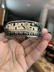 Sterling Silver and 14K Storyteller Gold Cuff By Navajo Mike Begay $1500.00