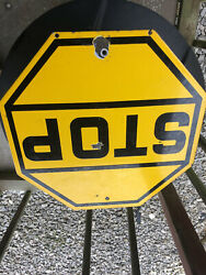 Older Yellow Porcelain Stop Sign