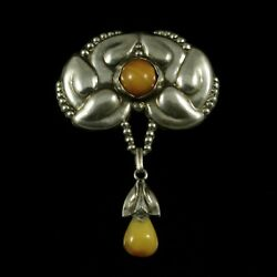 Evald Nielsen 1879 - 1958. Art Nouveau Silver Brooch With Amber