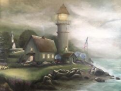lighthouse Church American flag seascape light footprints in the sand