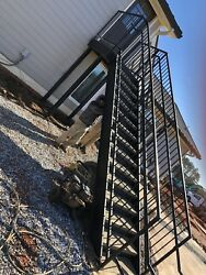 8 Feet Tall Steel And Concrete Steps Including Landing Pad.