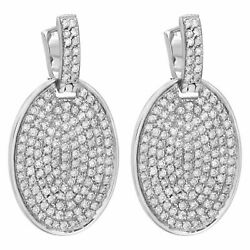 Pave diamond disc drop earrings in 18k white gold. 7.0 carats (F-G color,...