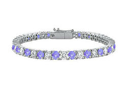 Created Tanzanite and Cubic Zirconia Prong Set 10K White Gold Tennis Bracelet 7