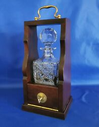 Single Mahogany Tantalus With Brass Fittings And 24 Cut Lead Crystal Decanter