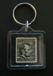 Postage Stamp Keychain   1282 – 1965 4c Prominent Americans Abraham Lincoln