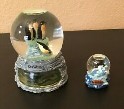 2 Sea World Snow Globes Penguins And Dolphin