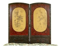 A 19th Century Japanese Lacquered Two Panel Carved Screen