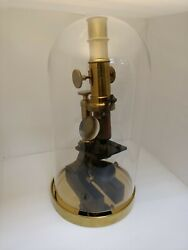 Antique Microscope, Brass, Mirror And Magnifier On The Case In A Glass Flask