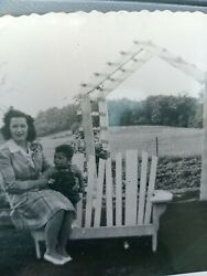 African American Female An Son Sitting On A Bench