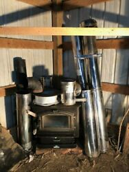 Breckwell Wood Stove complete with over 20 feet of stainless steelchimney stack $750.00