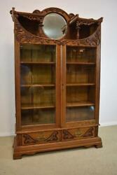 Antique Turn Of The Century Oak Two Door Bookcase Carved Round Beveled Mirror