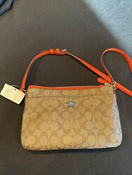 Tan Crossbody Coach Purse With Red Strap. Brand New With Tags $75.00