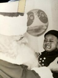 African American Boy Crying He Doesn't Want To Be With Santa